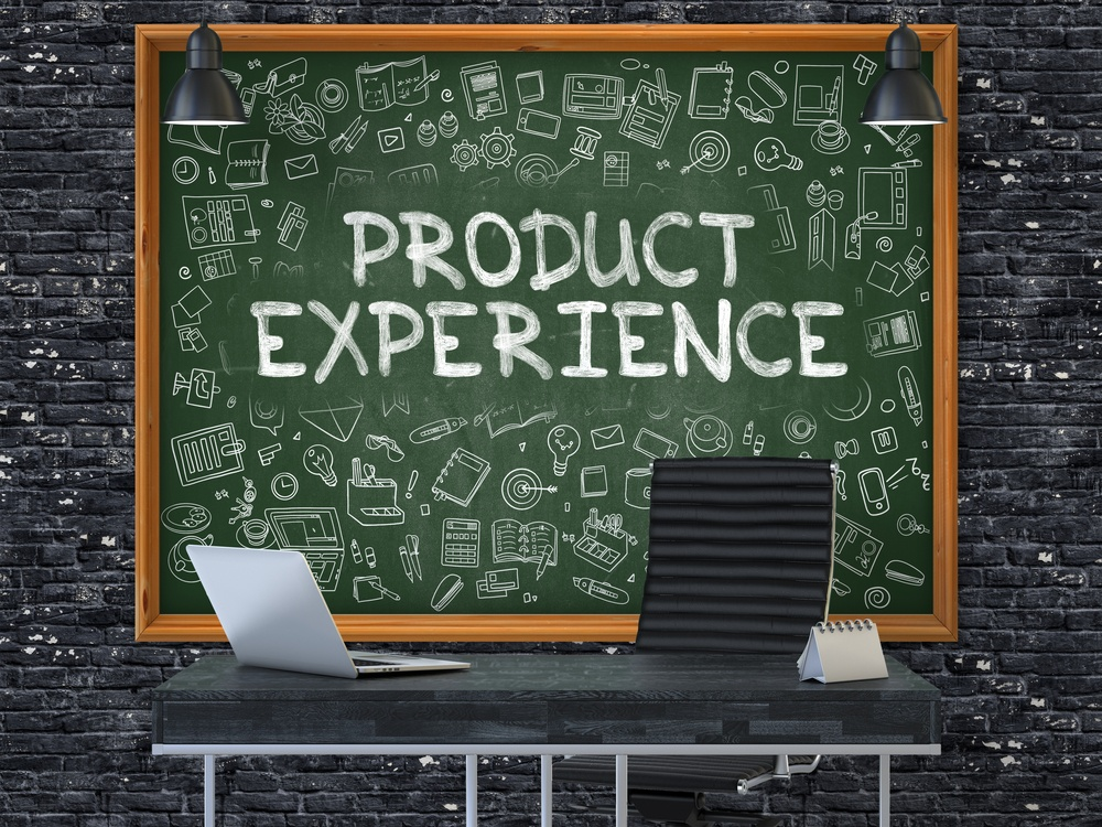 Green Chalkboard with the Text Product Experience Hangs on the Dark Brick Wall in the Interior of a Modern Office. Illustration with Doodle Style Elements. 3D..jpeg