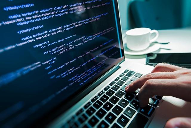 Programmer-working-computer-code