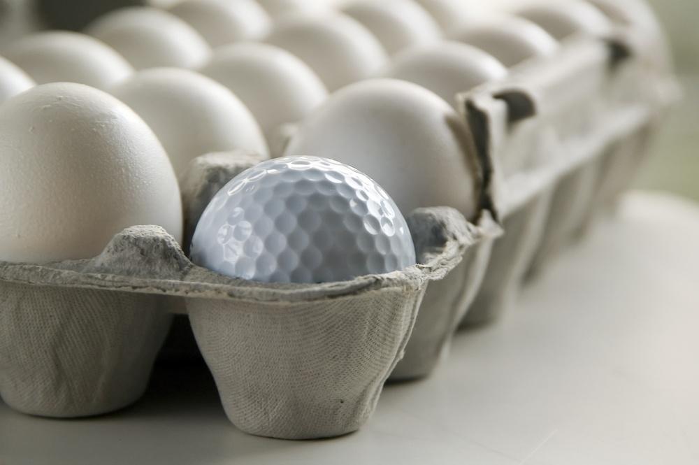 Golf ball and eggs in an egg carton.jpeg